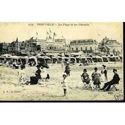 14 - Trouville - La plage et ses parasols